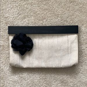 The Limited tan and black clutch